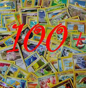100+ different Pokemon trading cards with metal tin