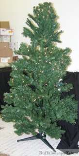 Pictured. 6.5 ft Sierra fir pre lit christmas tree w/clear lights